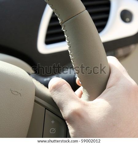 Driving a car on the highway.