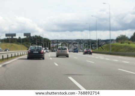 Driving a car on the highway in good weather conditions #768892714