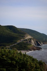 Driving along the Cabot Trail Mountainside with an Ocean View in Cape Breton, Nova Scotia