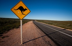 Driving around the Shark Bay in Western Australia - a kangaroo warning road sign.
