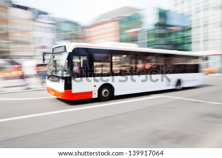 driving bus in city traffic in motion blur