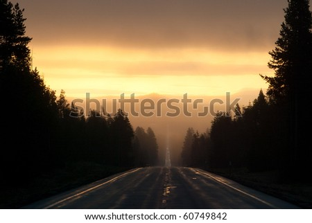 Driving down the road into the sun