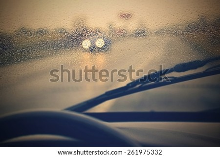Driving from the driver\'s perspective in bad weather in the rain.