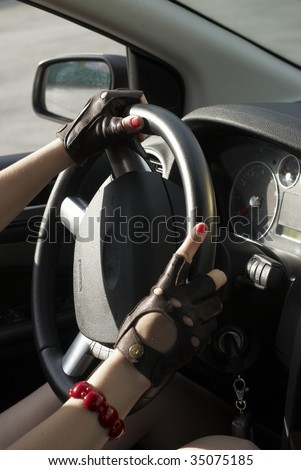 Driving girl with hands on wheel steering