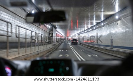 Driving in Lincoln tunnel, New York. View from the interior of a car. Speed limit 35mph on the asphalt