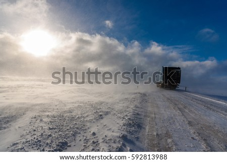 Driving into the blizzard - breathtaking Iceland in winter - amazing landscapes, storms and blizzards - photographers paradise  #592813988