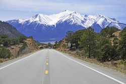 Driving into the Snow Capped Rocky Mountains, USA
