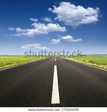 Driving on an empty road at lovely sunny day