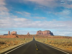 driving on highway 163 on a sunny spring morning at monument valley