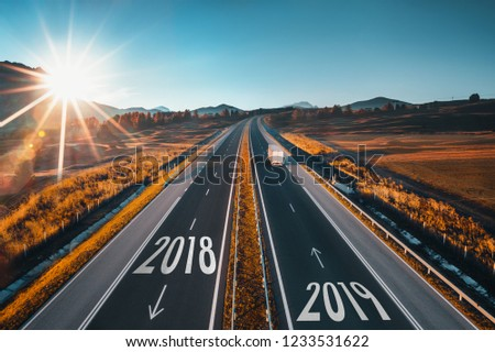 Driving on open road at beautiful sunny day from 2018 to new year 2019
