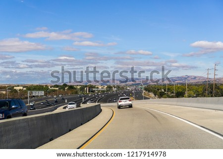 Driving on the express lane to switch between highways; Highway 880 visible in the background, south San Francisco bay, California #1217914978