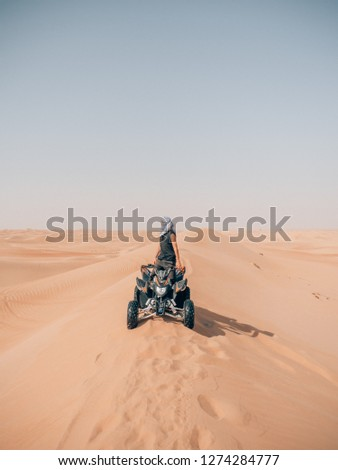driving quad in the desert of dubai Stock photo ©