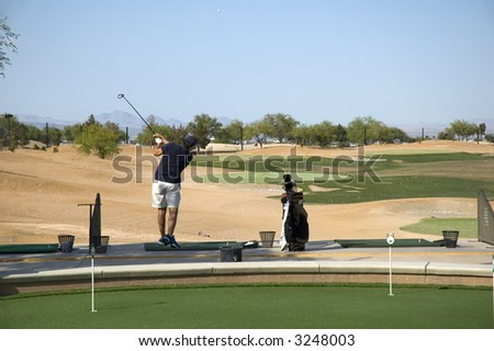Driving Range on a very hazy day - stock photo
