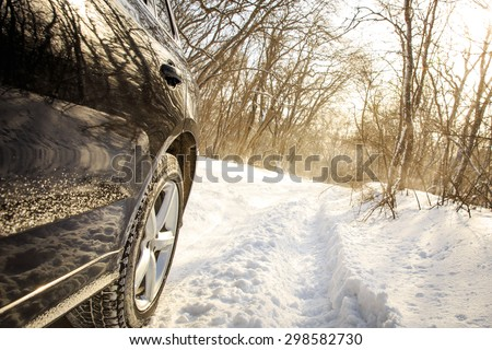 Driving SUV car in winter on forest road with much snow #298582730
