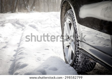 Driving SUV car in winter on forest road with much snow #298582799