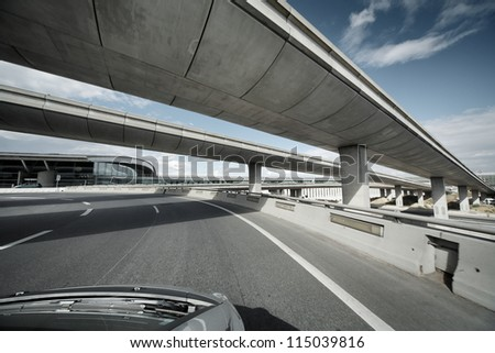 Driving under overpass road bridges. #115039816
