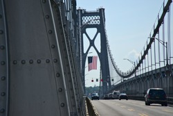 Driving underneath the American flag on the Mid-Hudson suspension bridge at 4th of July, Poughkeepsie