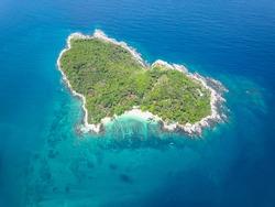 Drone Aerial Shot of Heart Shape Island Ko Kaeo Yai off the Coast of Laem Phromthep Cape Phuket Thailand
