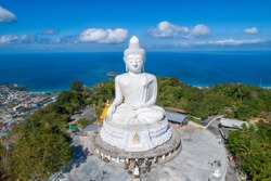 Drone Aerial view.Big Buddha of Phuket Thailand.Blue sky and blue ocean are on the back of Big Buddha white statue.Big Buddha Phuket is the one of landmarks on Phuket Thailand.(up to date)