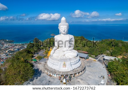 Photo of  Drone Aerial view.Big Buddha of Phuket Thailand.Blue sky and blue ocean are on the back of Big Buddha white statue.Big Buddha Phuket is the one of landmarks on Phuket Thailand.(up to date)