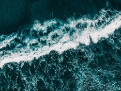 Drone aerial view ocean waves. Blue water background