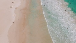 Drone aerial view of Redgate Beach, Margaret River, Australia (surfers, waves and beach goers)