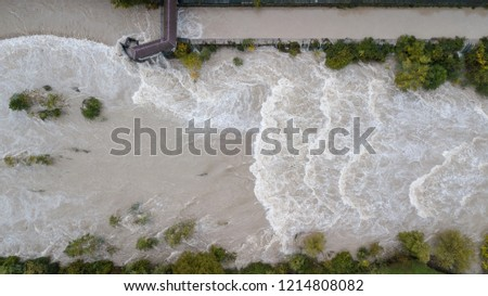 Drone aerial view of the Serio river swollen after heavy rains. Province of Bergamo, northern Italy