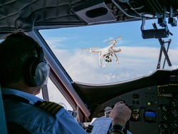 Drone being hit by commercial airplane. Concept of aircraft accident. Thread of collision