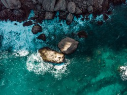 Drone, Bird's eye, Aerial top-down view of the Blue water and rocky formations at Cap de Formentor, Palma de Mallorca, Balearic Islands, Spain