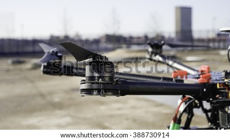 Drone close up in a urban setting. Image shows details of a multi rotor drone with an urban. background