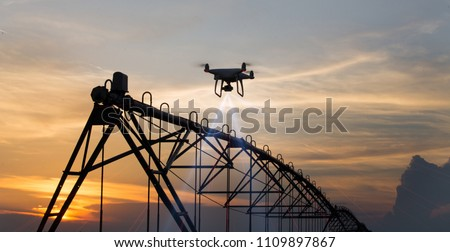 Drone flying and mapping field in front of irrigation system. Farmland surveying and modern technology improvement in crop production #1109897867