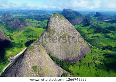 Drone flying between high mountains and rocks. Precious stones circuit. Minas Gerais, Brazil. Great landscape. Beautiful bird view and airplane scene. #1266948583