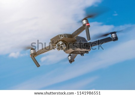 Drone flying high in the sky taking aerial photos