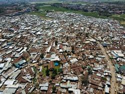 Drone flying in the slums of kibera kenya, poor houses captured by drone in the slums of kibera.