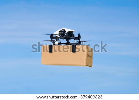 Drone flying through the air with a delivery box package clamped on to deliver to customer