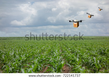 drone flying transportation in agriculture concept, smart farmer use a drone(artificial intelligence technology delivery to send a tool kit, product, fruit, vegetable in the farm,  to another place #722141737