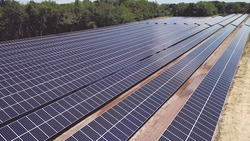Drone high angle view of solar energy panels during sunny day. photovoltaic PV system in Solar array of a solar farm.