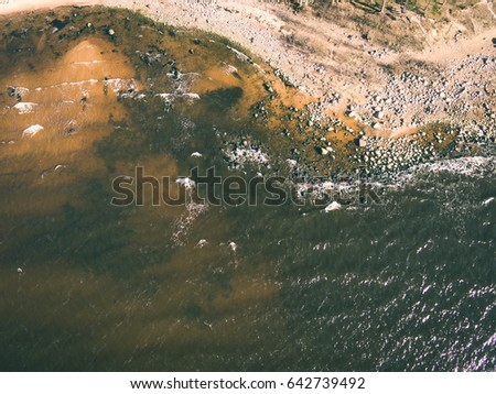 drone image. aerial view of baltic beach coast in sunny spring day. latvia - vintage effect
