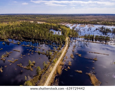 drone image. aerial view of rural area with swamp lakes with blue water #639729442
