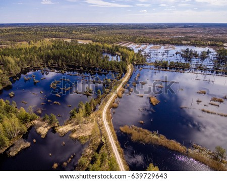 drone image. aerial view of rural area with swamp lakes with blue water #639729643