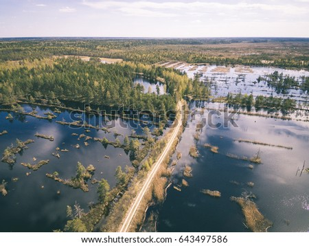 drone image. aerial view of rural area with swamp lakes with blue water - vintage effect #643497586