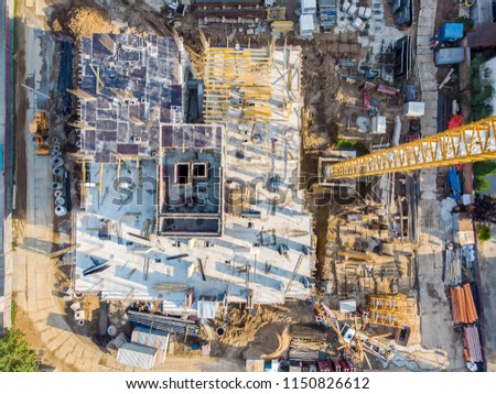 drone photo of construction site. tower cranes and industrial machinery for building construction