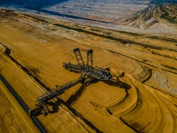 Drone photo of the biggest lignite opencast mine in Europe - German mine in Hambach with the giant Bagger 288 excavator, visible layers of removed soil, environmental degradation documented
