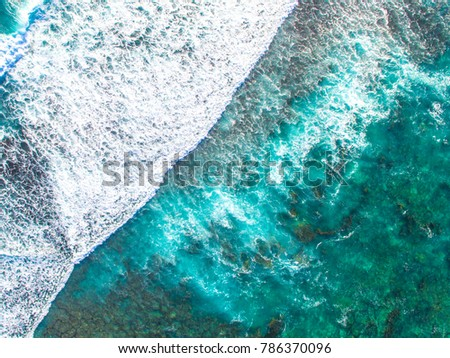 Drone photo of waves washing over the reef at Lancelin, Western Australia