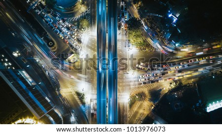 Drone photography of busy streets of modern metropolis #1013976073