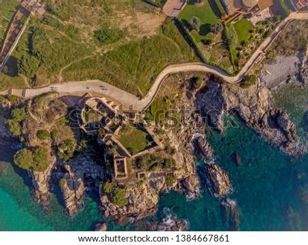 Drone picture over the Costa Brava coastal, small village La Fosca of Spain, old castle aerial picture