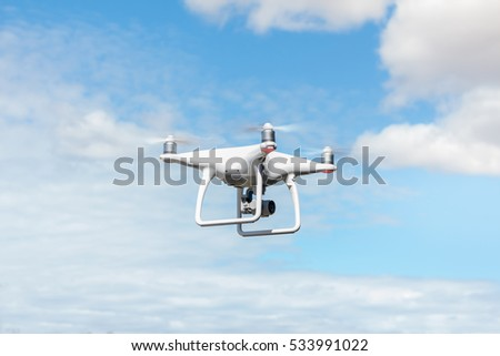Shutterstock drone quad copter with high resolution digital camera on the sky