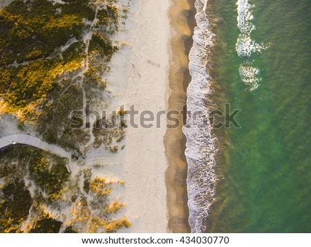 Drone shot. Aerial photography. East coast white sand beach aerial photography. Drone photography of a beach. Beautiful view from above.