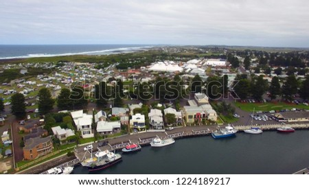 Drone shot of folk music festival with Port Fairy in foreground. #1224189217