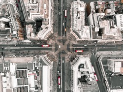 Drone shot of Oxford Circus during the day, with cars and red buses